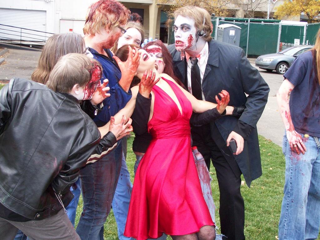 Zombies swarm woman