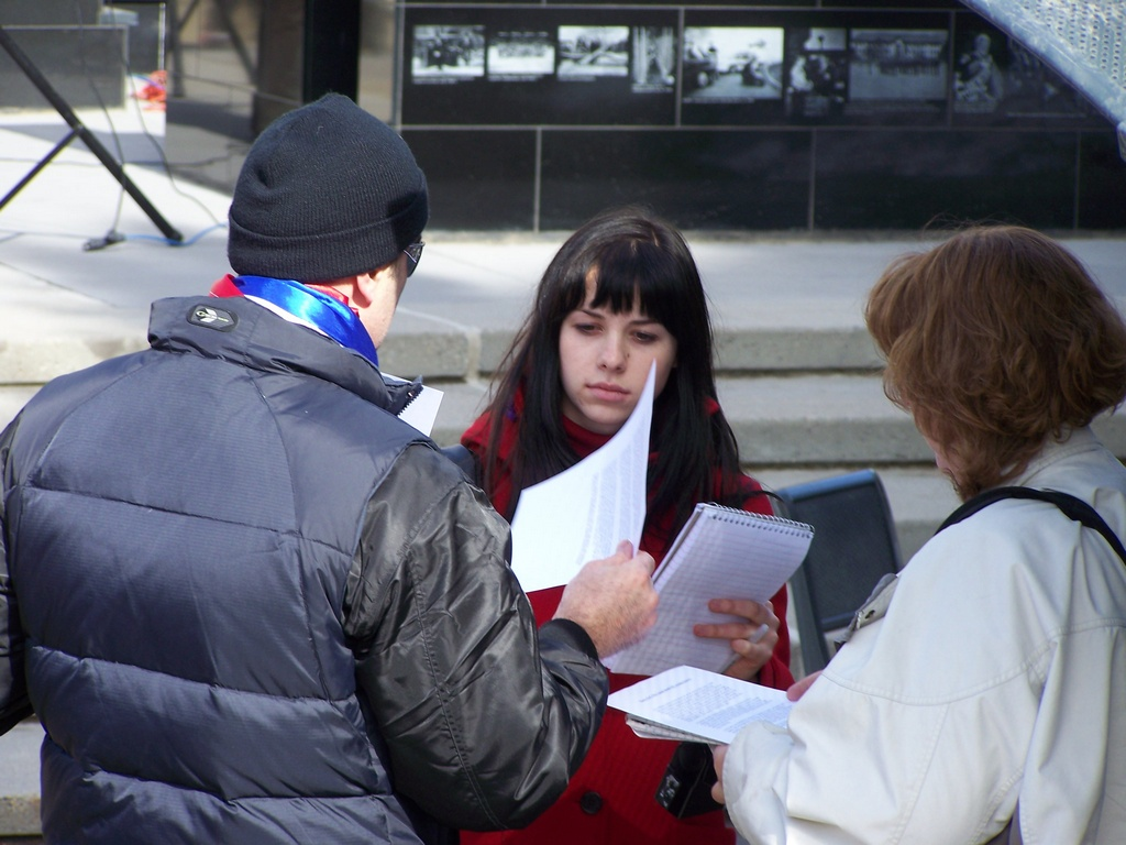 Handing out literature at Kosovo Rally