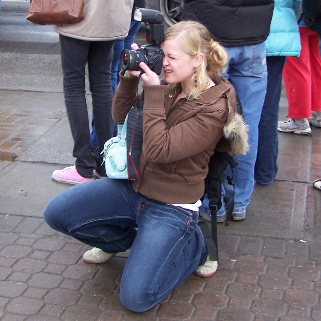 Kneeling for a photo at anti-war rally