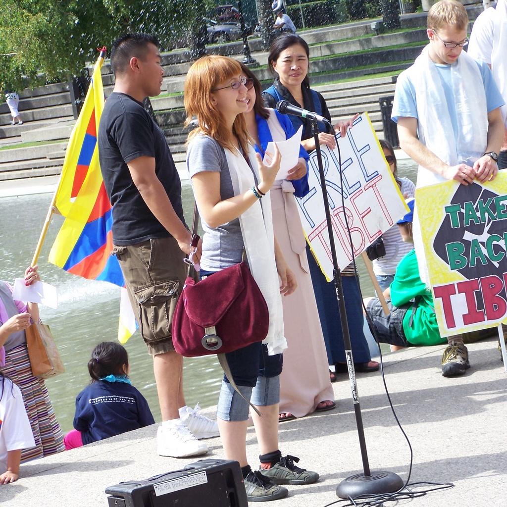 Denise Ogonoski speaks at Olympic Plaza