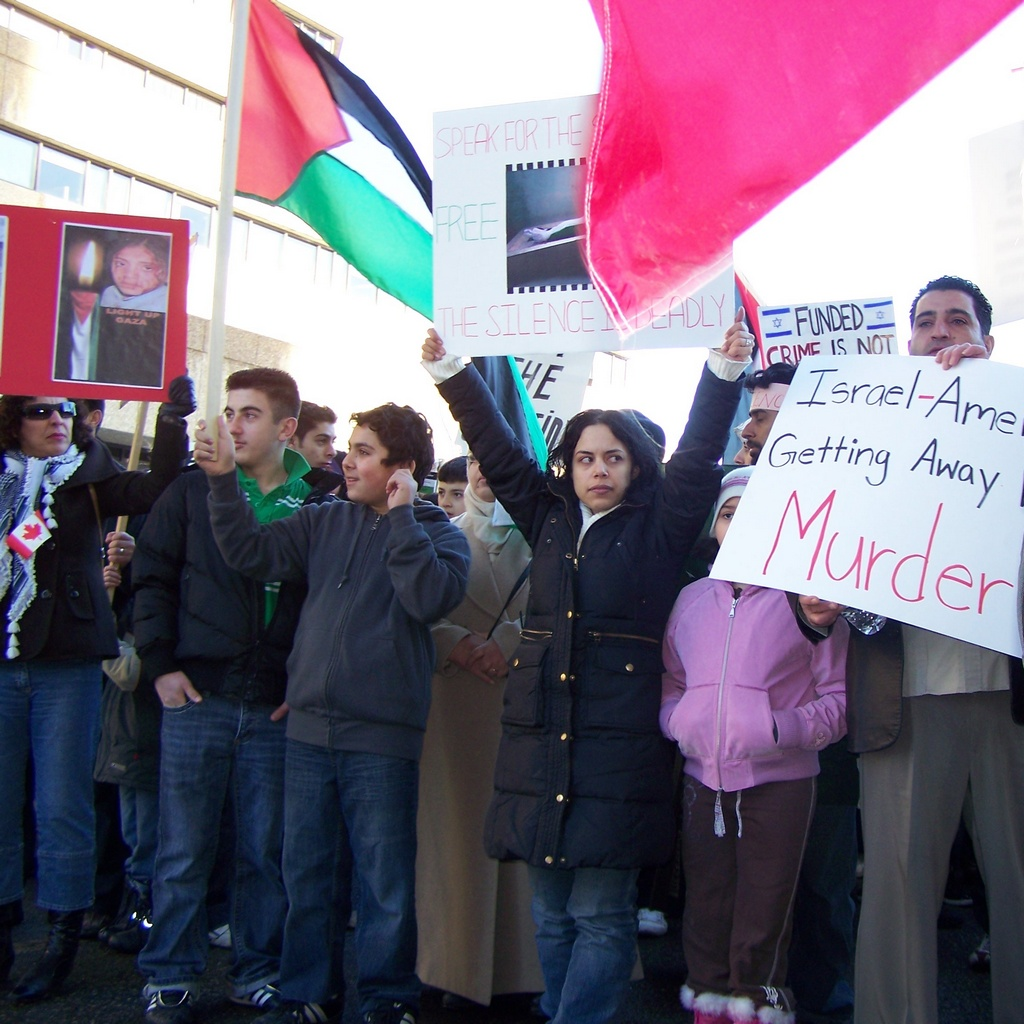 Holding up signs for Gaza
