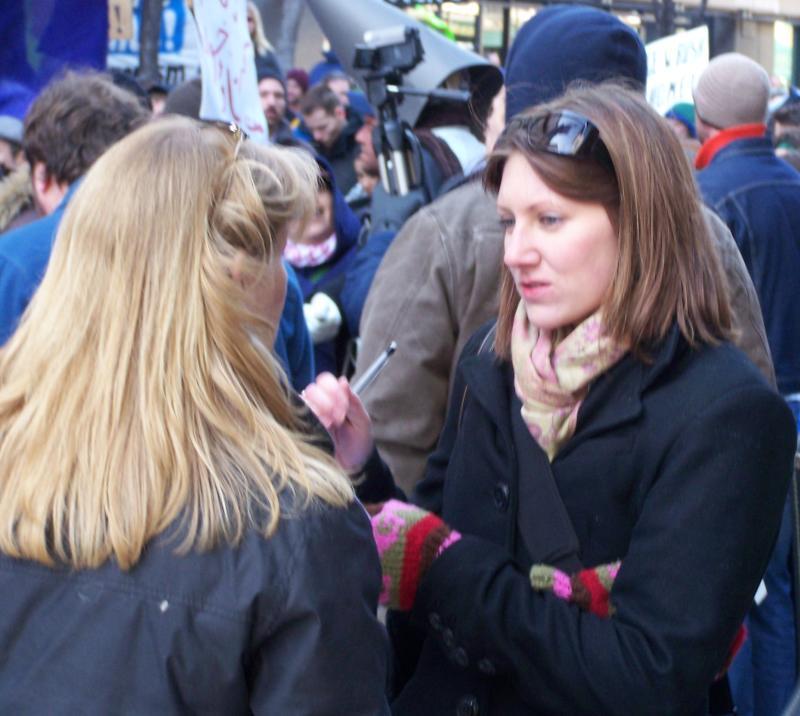 Katie Schneider covering Bush protest