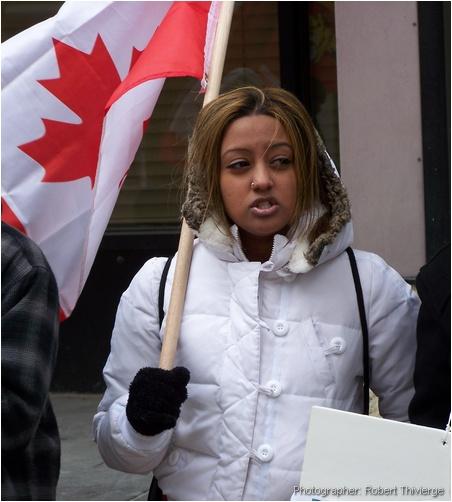 Tamil girl holds Canadian flag