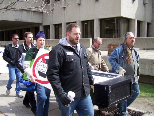 Carrying symbolic coffin for fallen workers