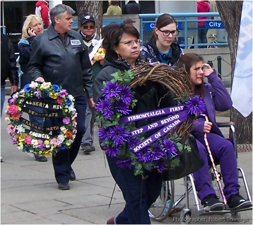 Carrying wreaths in procession