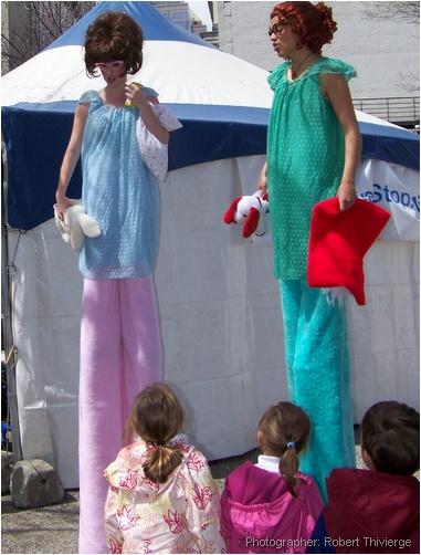 Stilted women entertain kids