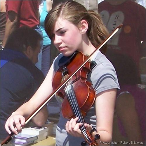 Girl plays violin at Lilac