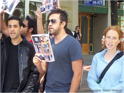 Holding pictures of crackdown in Iran