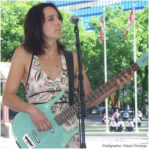Emily on guitar with Magnolia Buckskin