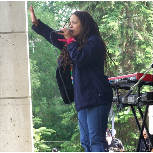 Sista J of Souljah Fyah sings