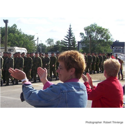 Clapping for the troops at Calgary Parade