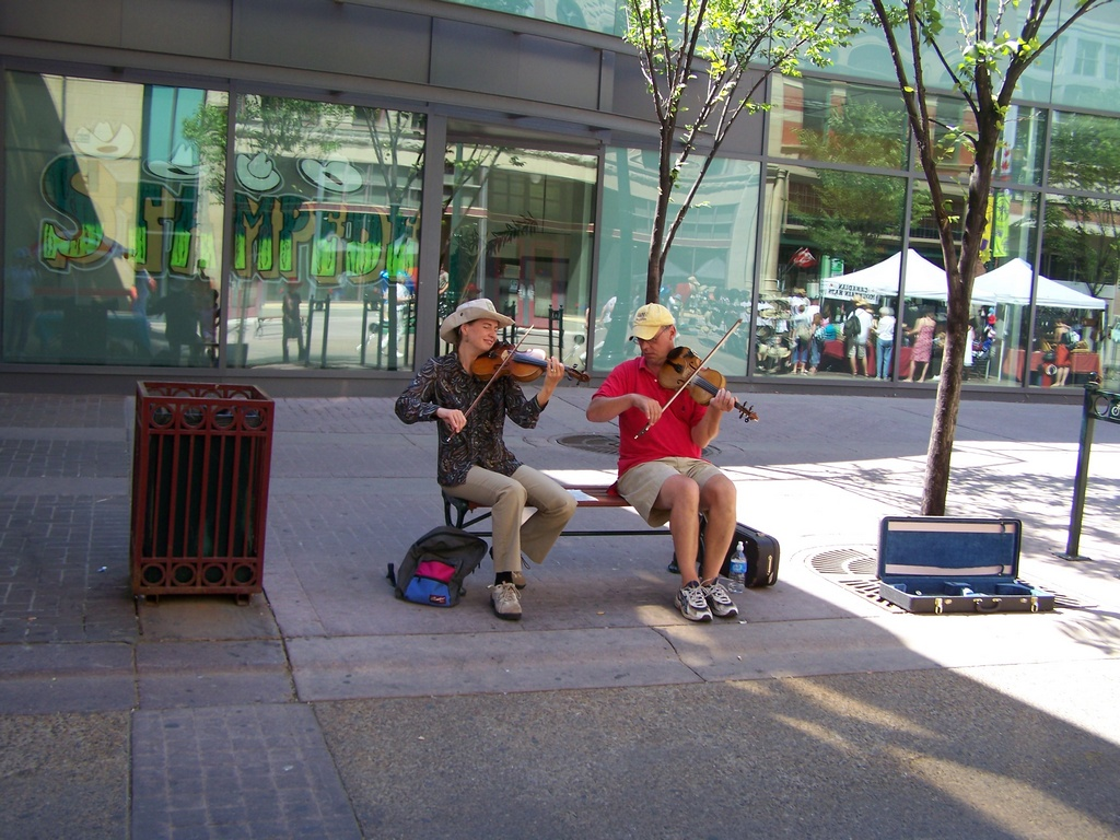 Man and woman fiddle on Stephen Avenue